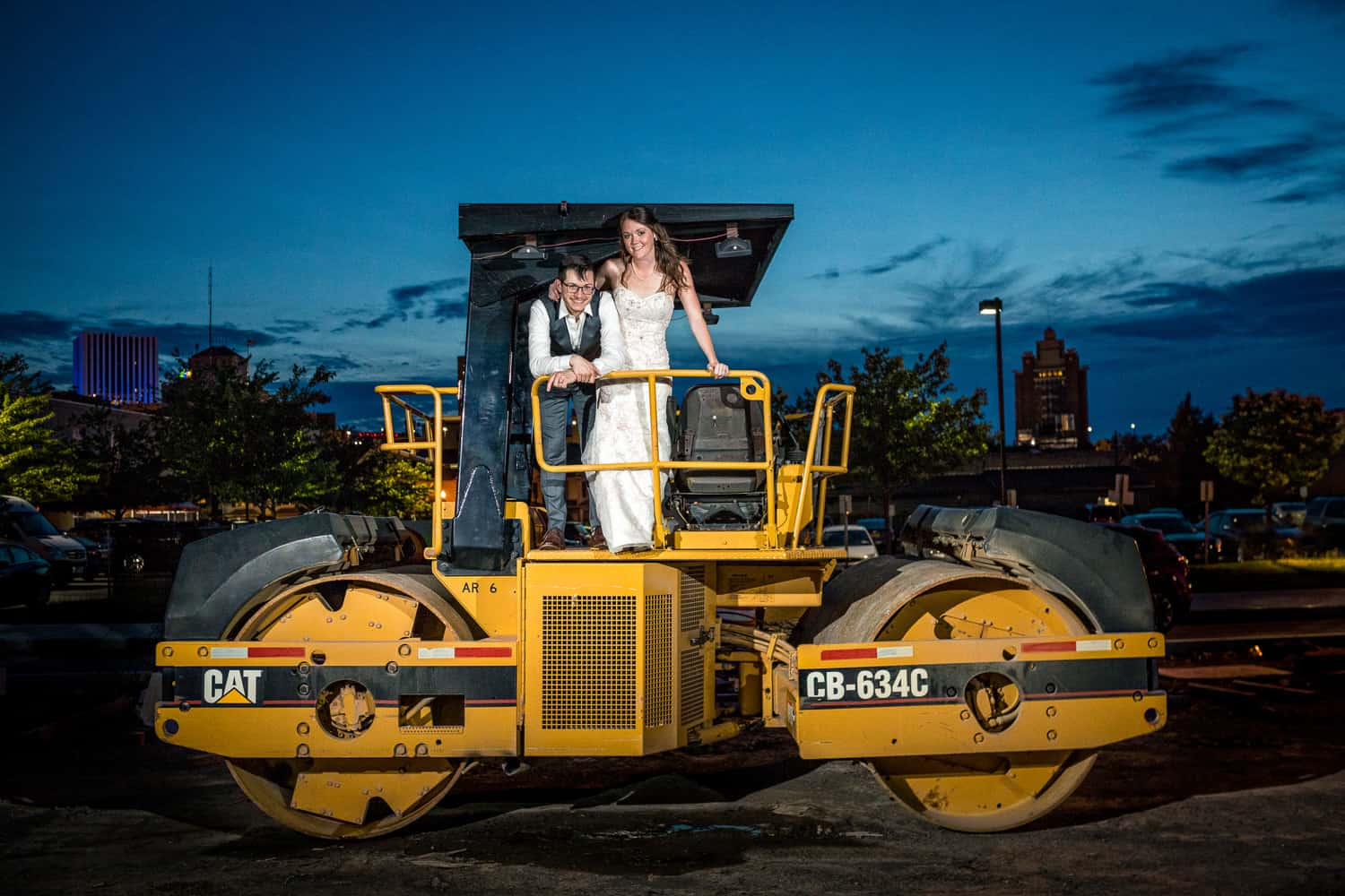 bride and groom wedding portrait at night, on a steam roller.