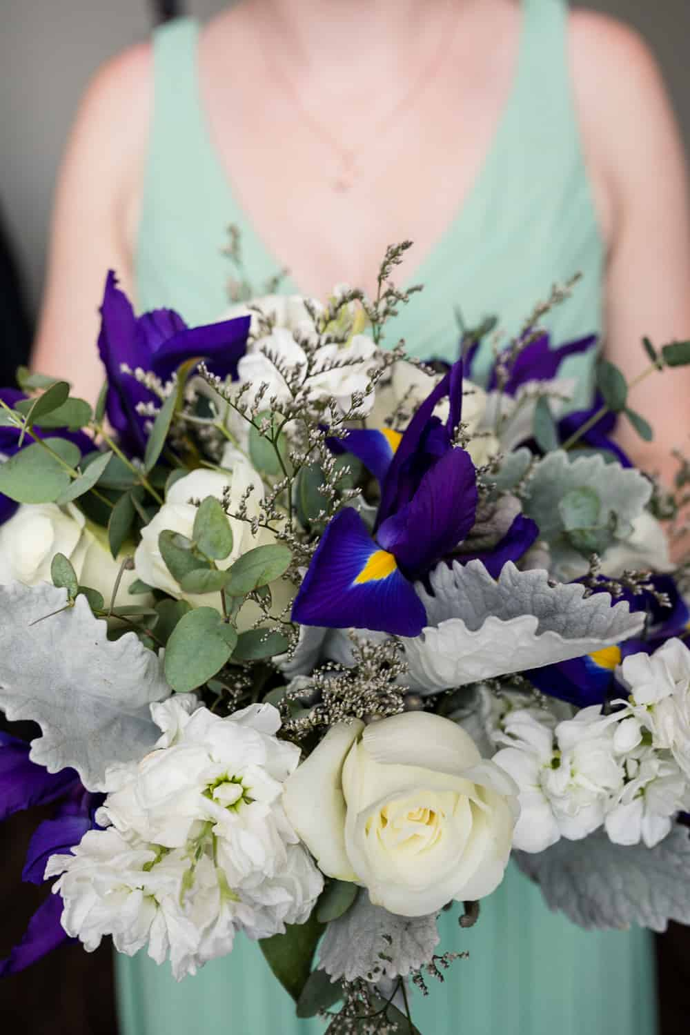 bridesmaides flowers with purple and white.