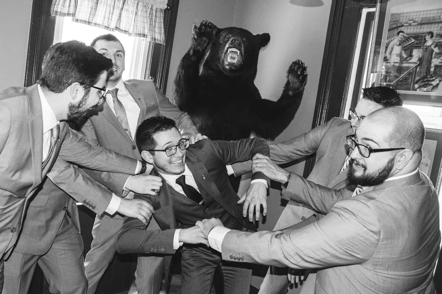 the groomsmen save the groom froma taxidermied bear.