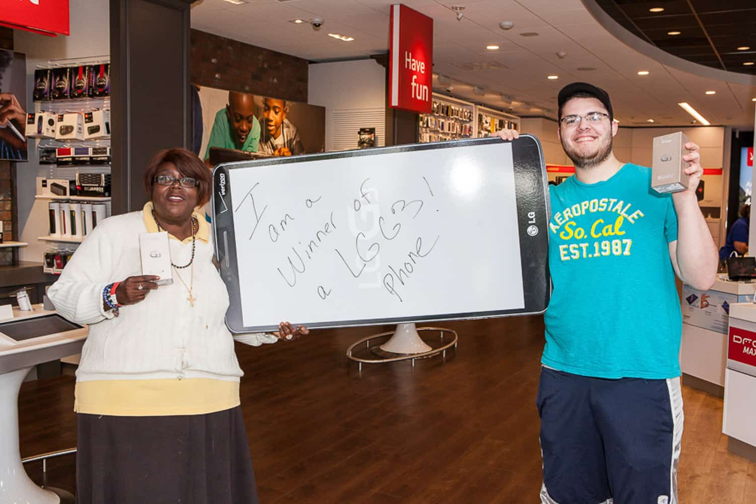 Event photograph of two people who won a new LG G3.