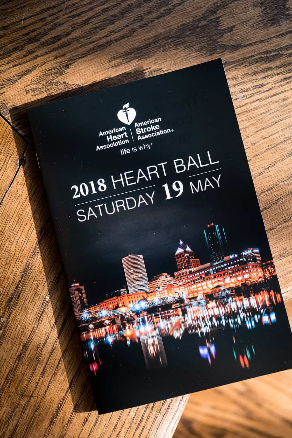 Event photography of the program cover for American Heart Association Heart Ball.