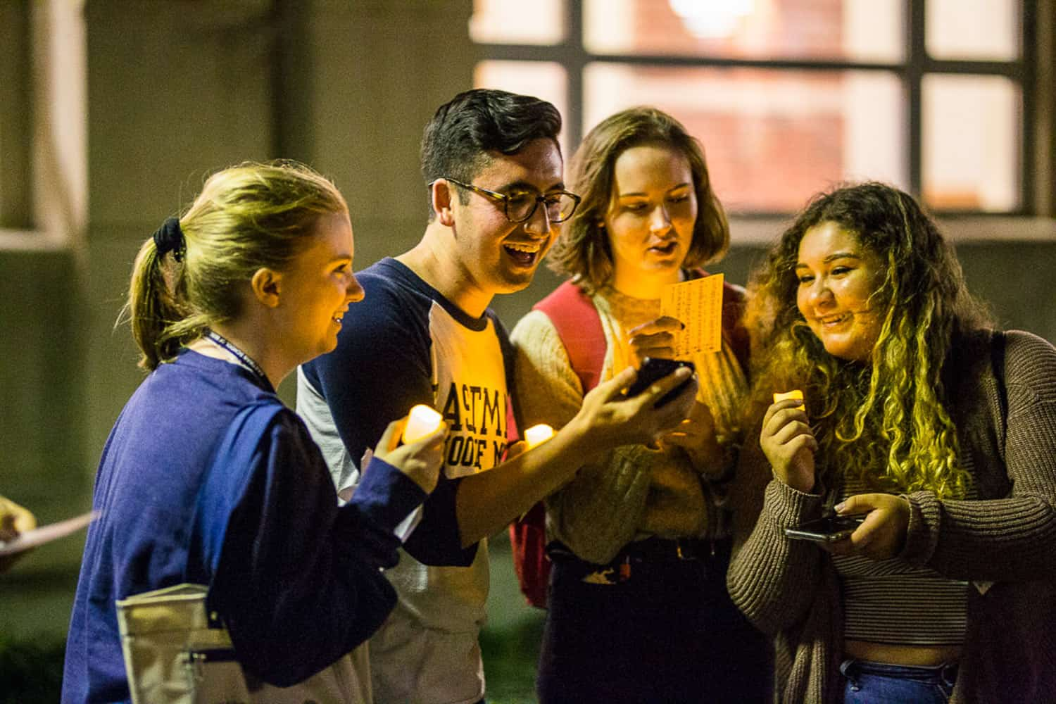 Photography of a group of friends at the Eastman School of Music candlelight ceremony event.
