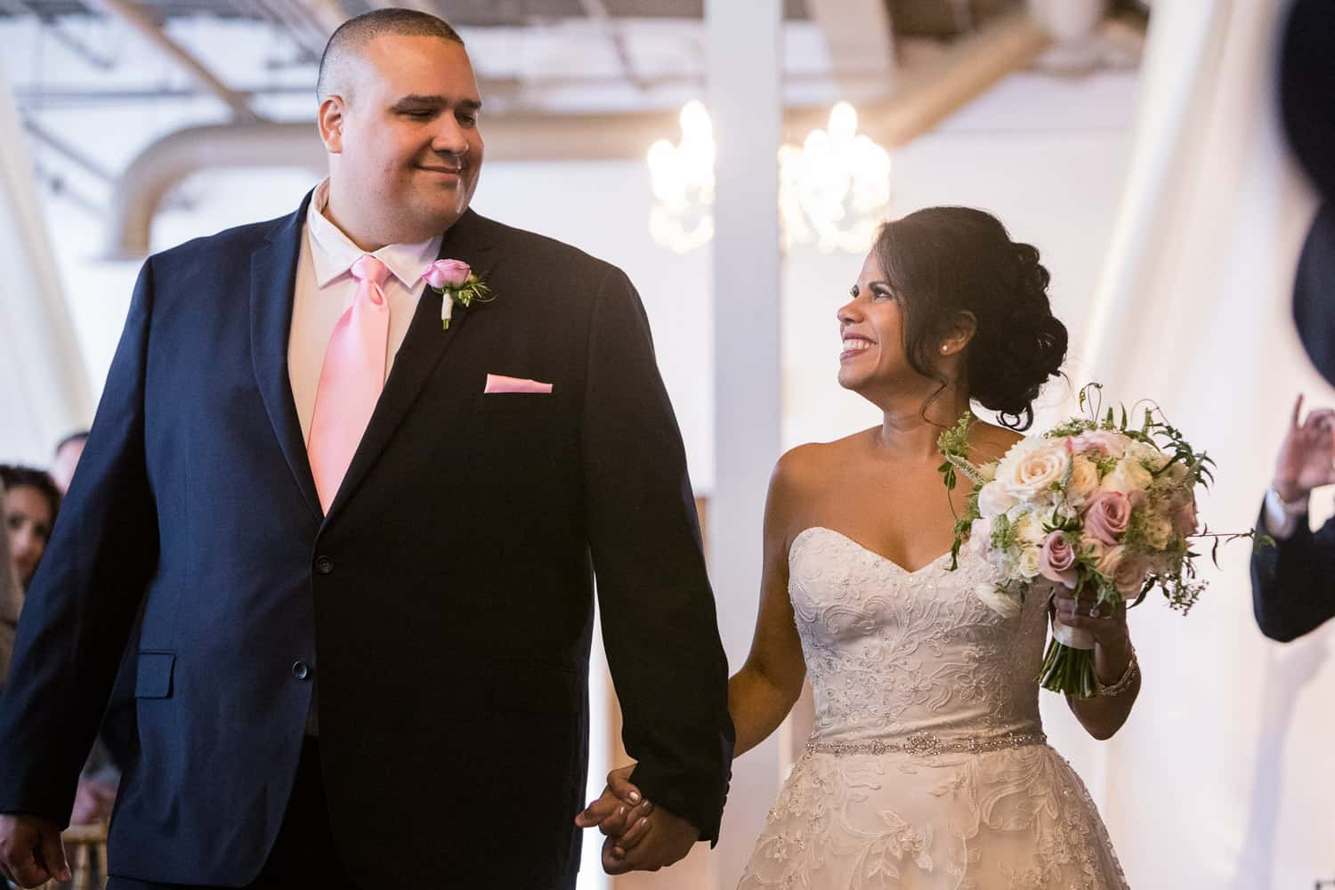 Rosemary's brother walks her down the aisle at her Arbor Loft Wedding.