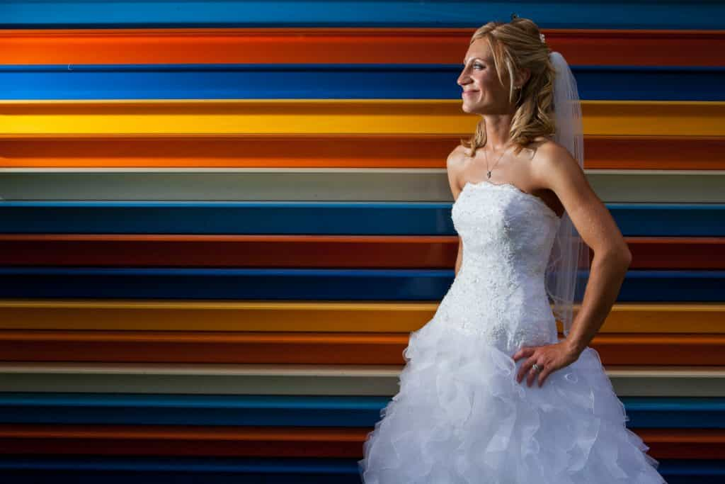 A rochester wedding photography portrait infront of a colorful sculpture.